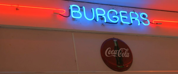 Neon burger sign with Coca Cola sign